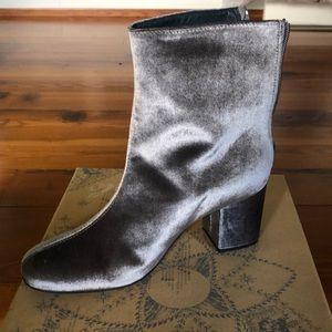 Grey velvet ankle boots.